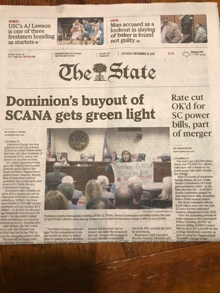 Newspaper with picture of the Dominion protest