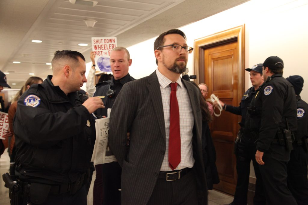 Drew is placed under arrest for disrupting the hearing of Andrew Wheeler for EPA Administrator